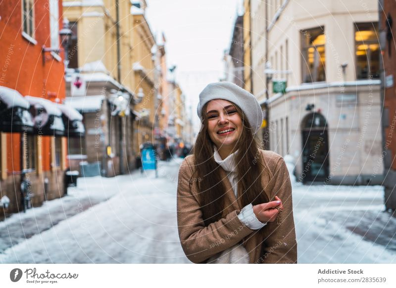 Attractive woman on snowy street Woman Style fashionable Youth (Young adults) Looking into the camera Street pretty Snow Winter Cold Coat Cool (slang) Fashion