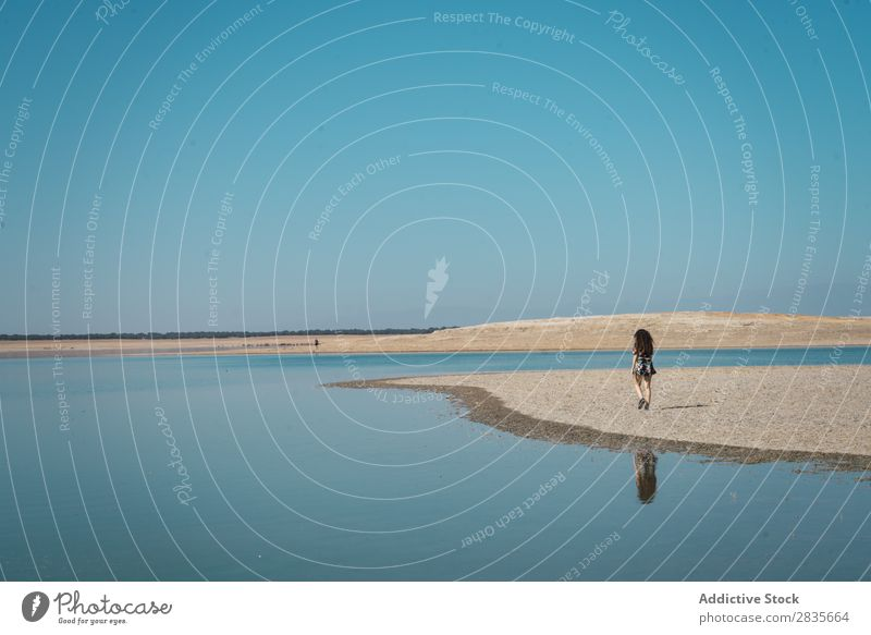 Silhouette of woman on shore of lake Woman Freedom Lake Traveling Summer Desert Sunlight Water traveler Nature Relaxation Tourist Landscape Exterior shot