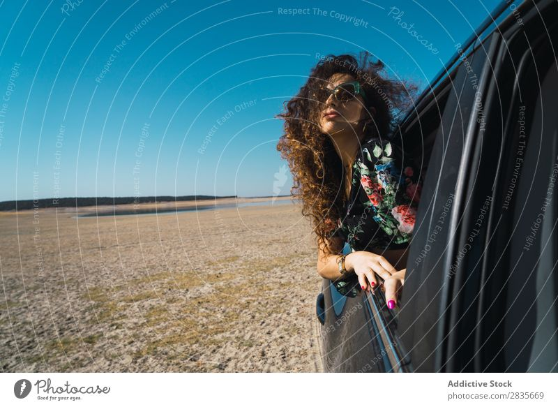 Woman enjoying riding car in desert Car Freedom Wind Window Speed Beauty Photography Vehicle