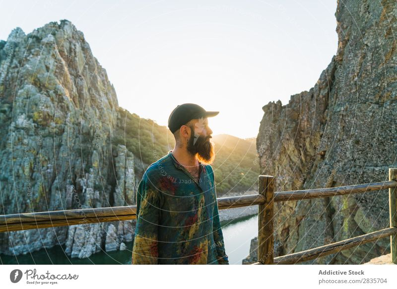 Confident man on rocky terrace Man traveler Relaxation Cliff Panorama (Format) Posture Self-confident Wanderlust Sunlight Masculine Vacation & Travel Fresh