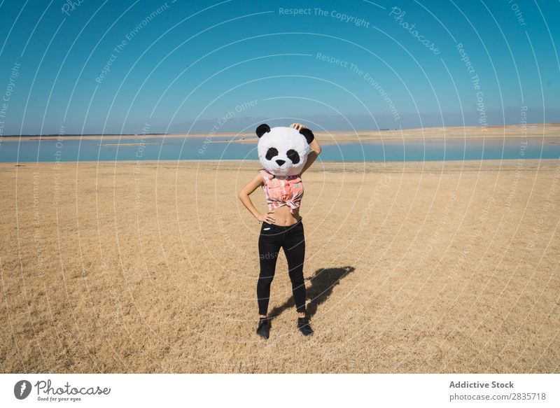 Woman with panda hat posing on nature Hat Creativity Panda Costume Traveling Nature Wear having fun Landscape Relaxation Wanderlust Artificial Style pose