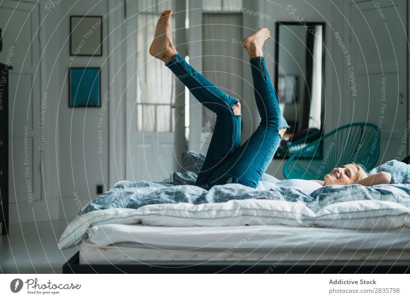 Woman lying with legs up pretty Home Youth (Young adults) Blonde Beautiful falling Lie (Untruth) Lifestyle Beauty Photography Attractive Portrait photograph