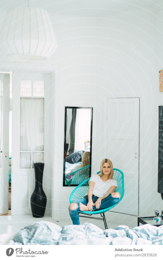 Young blonde woman sitting in chair Woman pretty Home Youth (Young adults) Blonde Looking into the camera Sit Chair Beautiful Lifestyle Beauty Photography