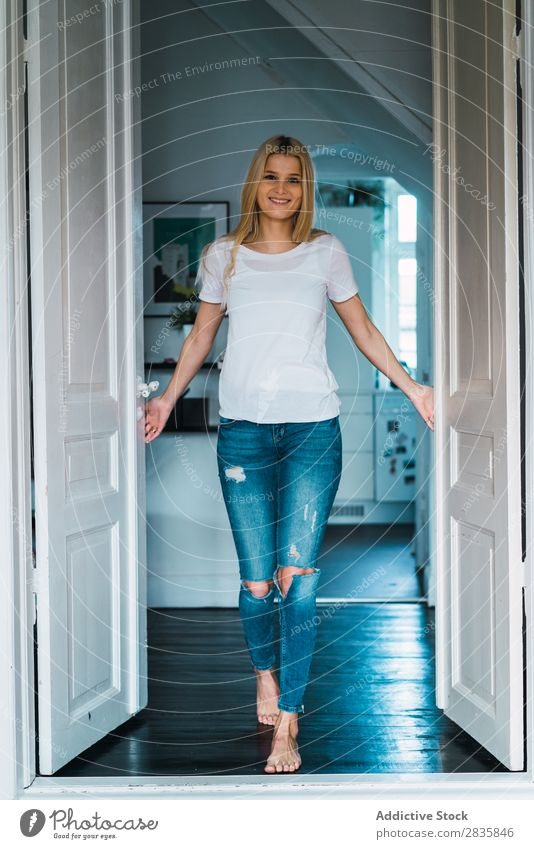 Cheerful woman in doorway Woman pretty Home Youth (Young adults) Blonde Smiling Stand Looking into the camera Beautiful Lifestyle Beauty Photography Attractive