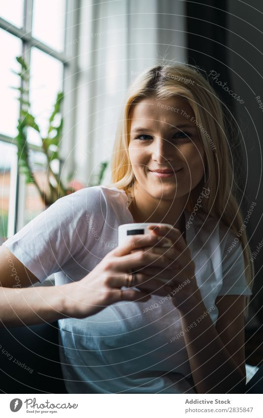 Smiling woman with cup Woman pretty Home Youth (Young adults) Blonde Cup delighted Drinking Looking into the camera Beautiful Lifestyle Beauty Photography