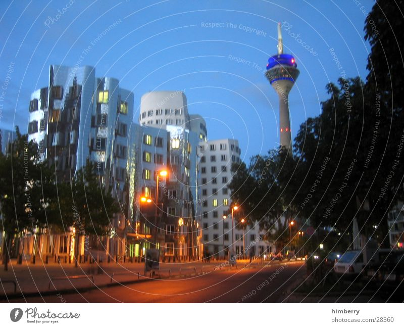City Building Architecture High-rise Lifestyle Modern Lantern Skyline Duesseldorf Television tower Night life Lighting effect Rheinturm