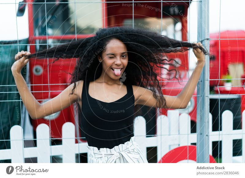 Playful woman winking Woman pretty Youth (Young adults) Portrait photograph tongue out making faces grimacing Looking into the camera Black African City Town