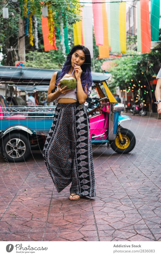 Young woman with coconut drink on street Woman pretty Street Youth (Young adults) Beautiful Portrait photograph Stand Coconut Drinking Straw Hair Purple asian