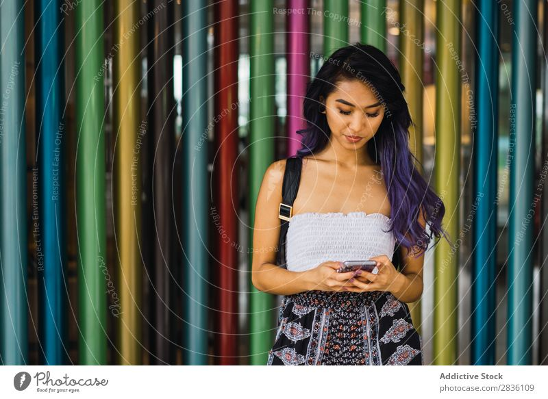 Young woman leaning on colorful columns Woman Street Youth (Young adults) Beautiful Column Lean Multicoloured Portrait photograph