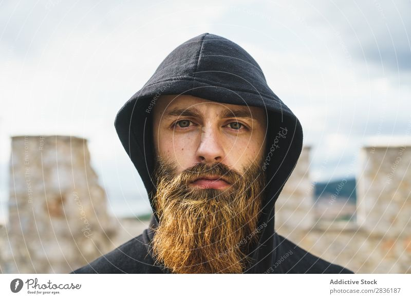 Bearded man in hood Man bearded Lifestyle Wanderlust human face traveler Car Hood Nature Portrait photograph Model Adventure Landscape handsome Easygoing