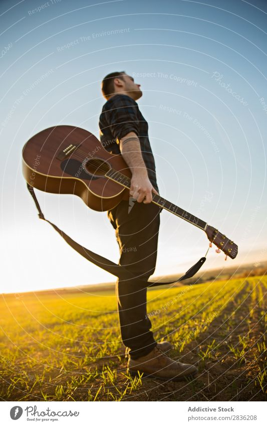 Man with guitar on field Guitar Nature Music Stand Lifestyle Musician Easygoing Guitarist Acoustic Field Green Walking Musical Human being Guy Natural