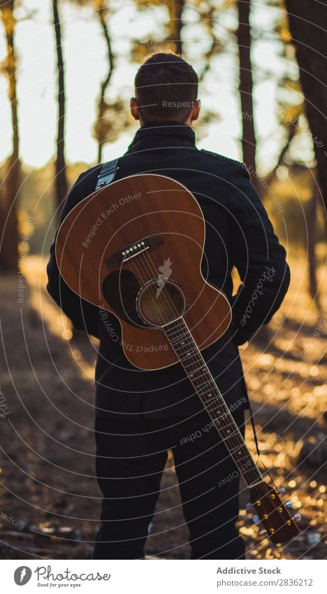 Man with guitar in woods Guitar Nature Music Forest Cool (slang) Lifestyle Musician Easygoing Guitarist Acoustic Autumn Musical Human being Guy Natural