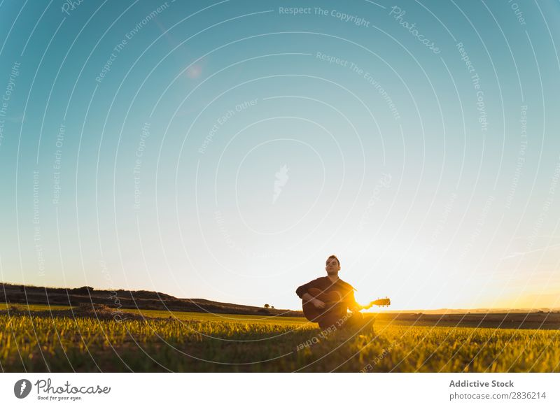 Man with guitar on field Guitar Nature Music Lifestyle Musician Easygoing Guitarist Acoustic Field Green Walking Musical Human being Guy Natural instrument