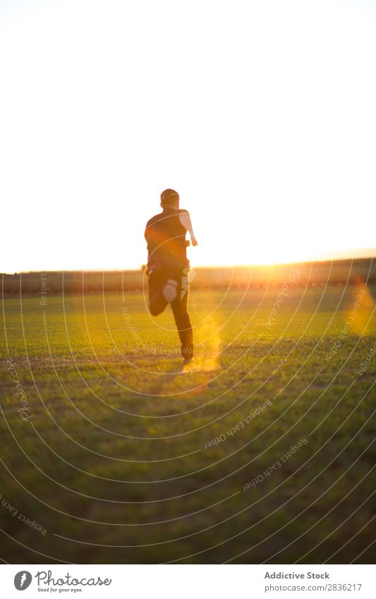 Man jumping on sunny field Field Joy Happiness Summer Freedom Nature Action Human being Youth (Young adults) Meadow Grass Energy Green Lifestyle Running