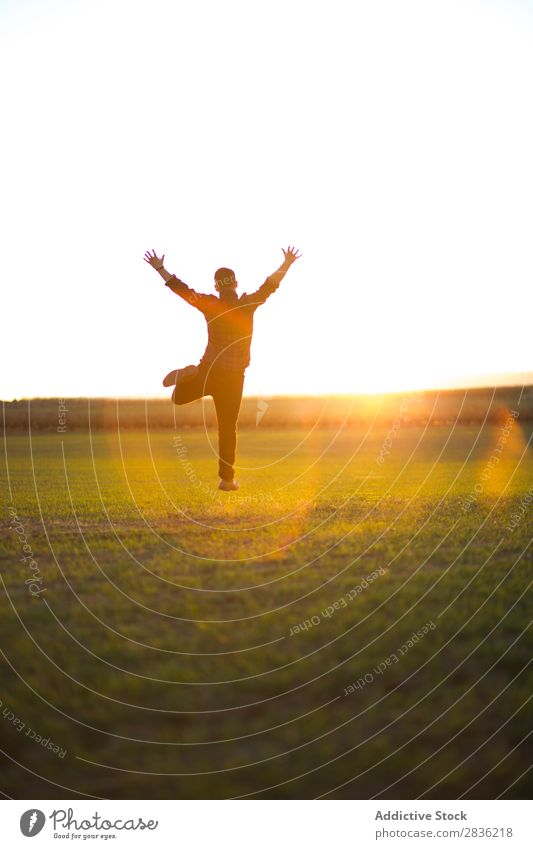 Man jumping on sunny field Field Joy Jump Happiness Summer Freedom Nature Action Human being Youth (Young adults) Meadow Grass Energy Green Lifestyle Running