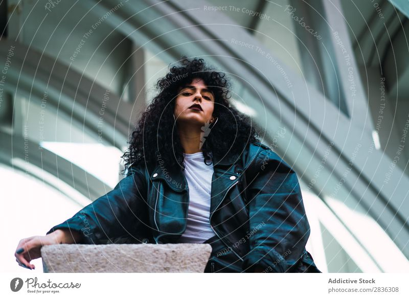 Stylish woman posing at fence Woman Attractive City fashionable Curly Brunette Fence Column Street Fashion Youth (Young adults) Beautiful pretty Model Style
