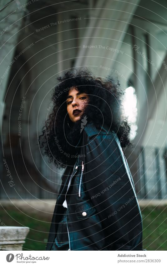Curly woman posing in city Woman Attractive City fashionable Brunette Jacket Fence Fashion Youth (Young adults) Beautiful pretty Street Model Style Hair