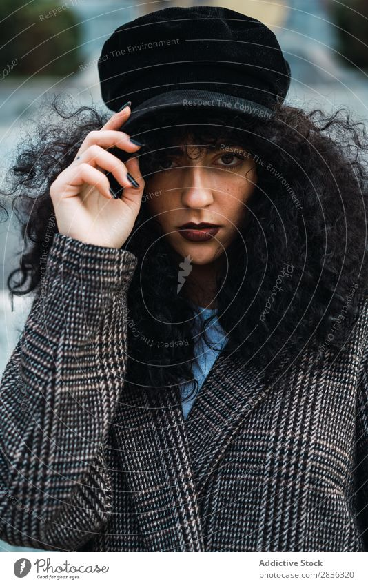 Pretty stylish woman in park Woman Attractive City fashionable Curly Brunette Park Green Coat Hat Fashion Youth (Young adults) Beautiful pretty Street Model