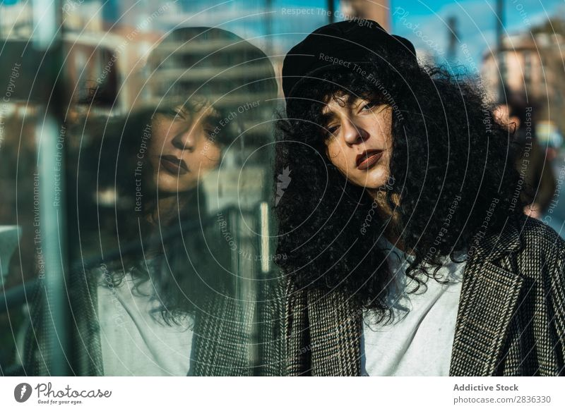 Attractive woman at case Woman City fashionable Curly To fall Glass Looking into the camera Brunette Fashion Youth (Young adults) Beautiful pretty Street Model