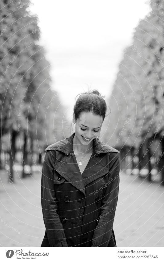 Madame from paris. Feminine Young woman Youth (Young adults) 1 Human being 18 - 30 years Adults Smiling Laughter Coat Trench coat Avenue Tree Braids Mouth open