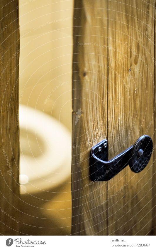 inlet [3] Toilet Door Wood Brown Yellow Tile Door handle Door lock Metal fitting Rustic Bowel movement place of tranquillity constipation Needs Colour photo