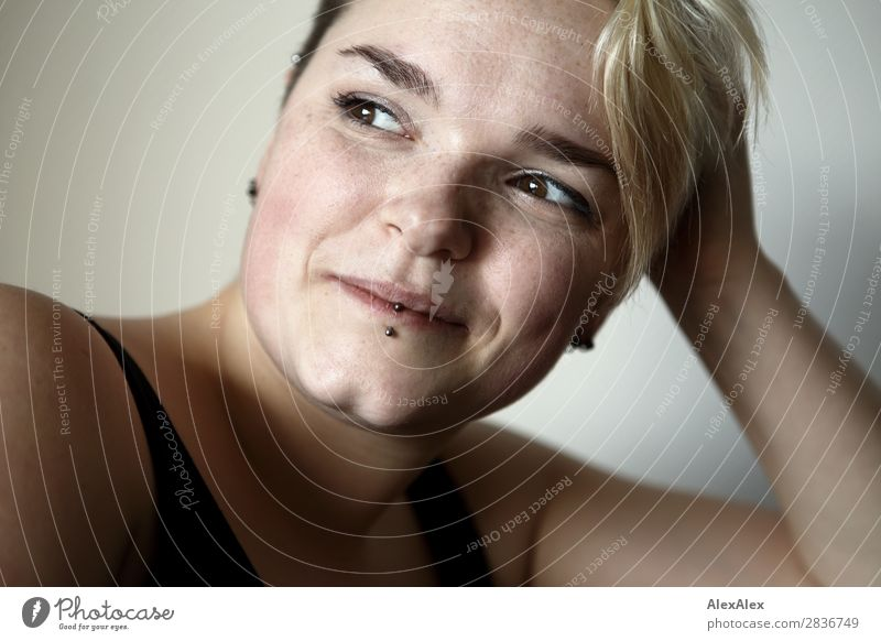 Portrait of a young smiling woman with freckles and dimples Joy pretty Life Well-being Young woman Youth (Young adults) pit 18 - 30 years Adults Piercing Blonde
