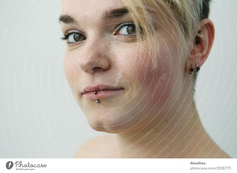 Young woman with freckles and short blonde hair looks sideways at camera Style pretty Face Life Flat (apartment) Youth (Young adults) Freckles 18 - 30 years