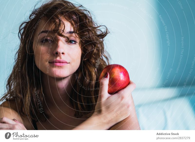 Attractive woman with apple Woman Home pretty Apple Food Dream Pensive Youth (Young adults) Posture Relaxation Portrait photograph Beautiful Lifestyle