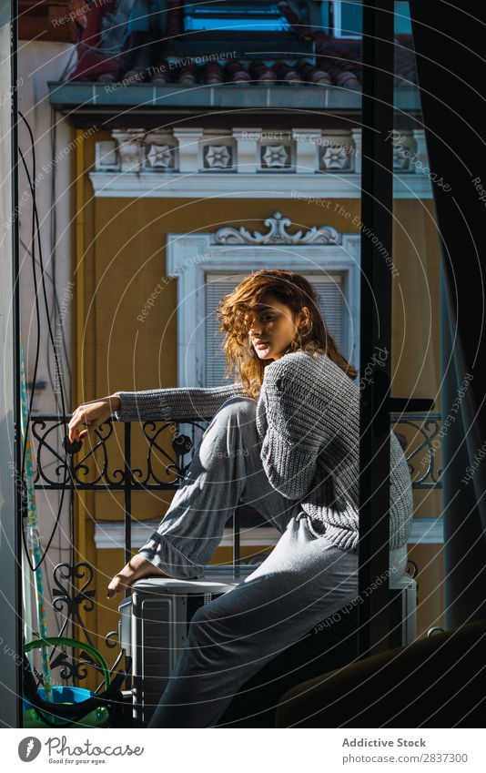 Young woman posing on balcony Woman Home pretty Balcony Relaxation Sit Youth (Young adults) Posture Portrait photograph Beautiful Lifestyle Beauty Photography