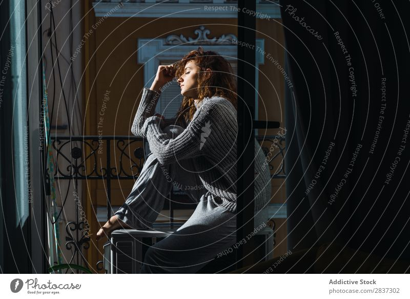 Young woman posing on balcony Woman Home Balcony Relaxation Sit Youth (Young adults) Posture Portrait photograph