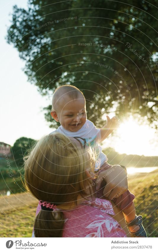 Mother with child in park Child Park Lawn Green Sunbeam Family & Relations Happy Human being Woman Happiness Summer Lifestyle Love Parents Nature