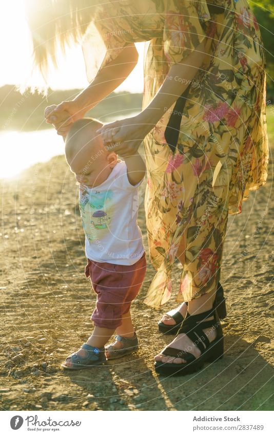 Mother holding walking child Child Park stepping School Walking Support Sunbeam Family & Relations Happy Human being Woman Happiness Summer Lifestyle Love