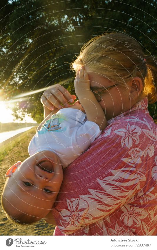 Mother playing with child in park Child Park Playing Sunbeam Family & Relations Happy Human being Woman Happiness Summer Lifestyle Love Parents Nature