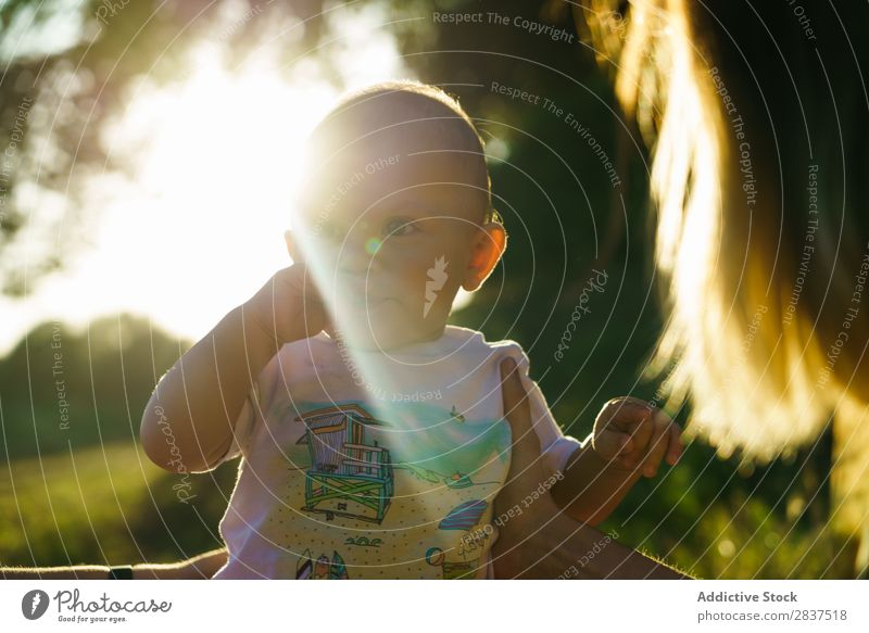 Cute little child in park Child Park Lawn Green Mother Sunbeam Family & Relations Happy Human being Woman Happiness Summer Lifestyle Love Parents Nature