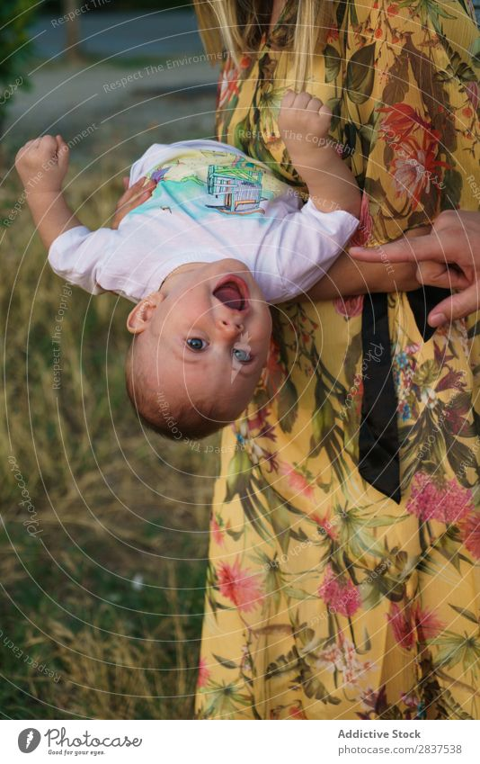 Cute child on hands of mother Child Park Lawn Green Mother Family & Relations Happy Human being Woman Happiness Summer Lifestyle Love Parents Nature