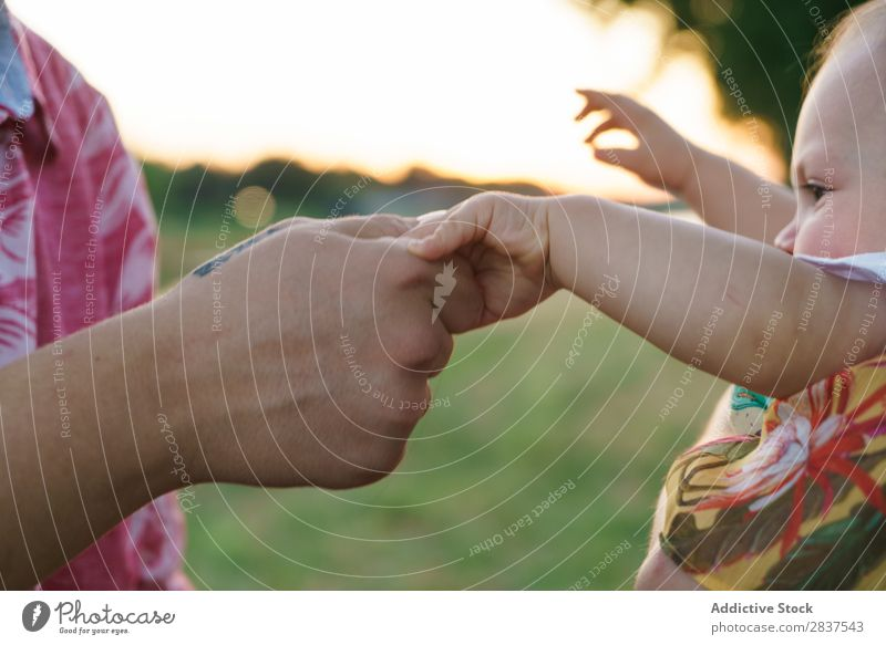 Mother and child holding hands Child Park Lawn Green Sunbeam Family & Relations Happy Human being Woman Happiness Summer Lifestyle Love Parents Nature
