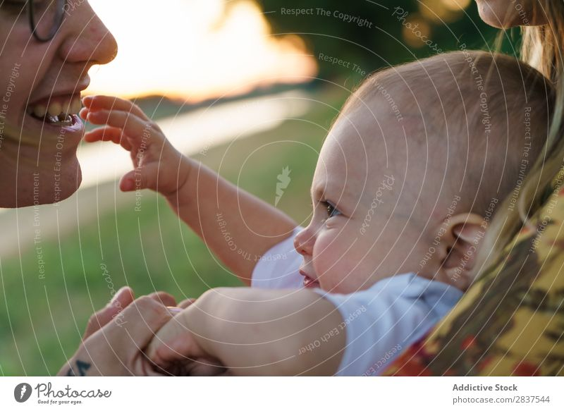 Mother and child having fun Child Park Lawn Green Sunbeam Family & Relations Happy Human being Woman Happiness Summer Lifestyle Love Parents Nature