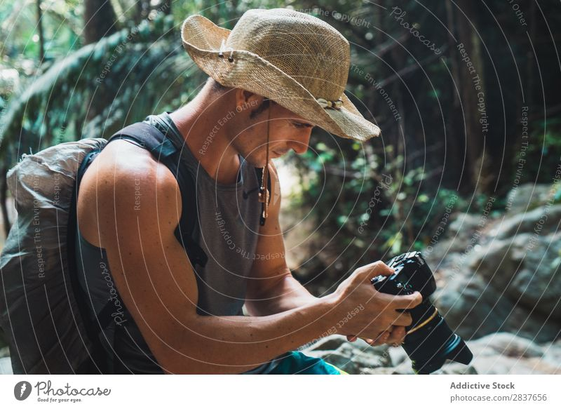 Handsome adult man setting camera Photographer Virgin forest Tourist Man Adults using Set Professional Vacation & Travel Forest Nature Tourism Landscape Natural