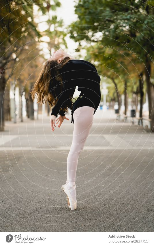Side view of female ballet dancer - a Royalty Free Stock Photo from ...