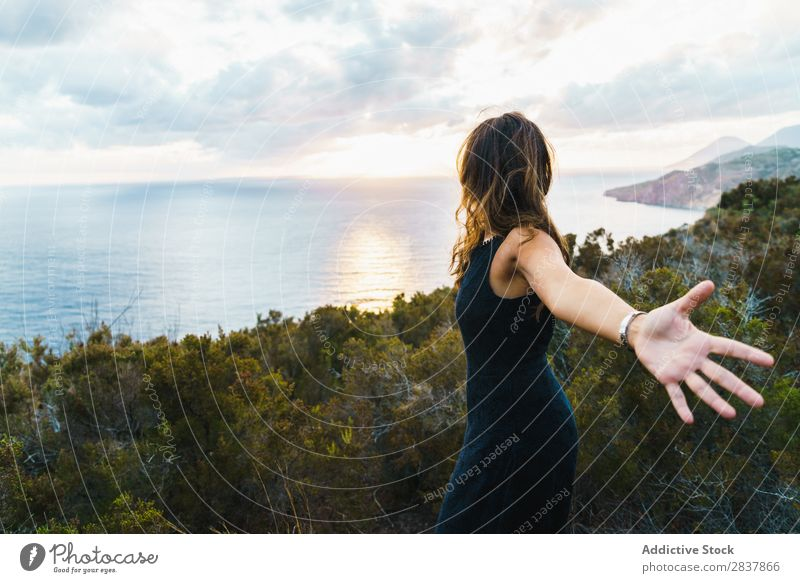 Woman posing on nature Landscape Posture Ocean Tourist Adventure Nature Panorama (Format) Freedom Relaxation Traveling romantic achievement Tropical Summer