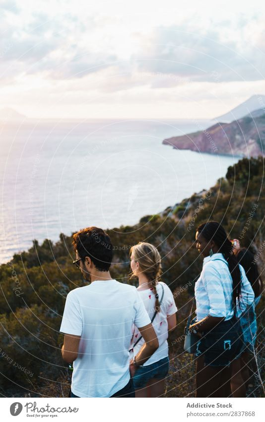 Group of people standing on cliff Human being Tourism Landscape Freedom Action Ocean Adventure Summer Exterior shot Vacation & Travel Tourist multiethnic Black
