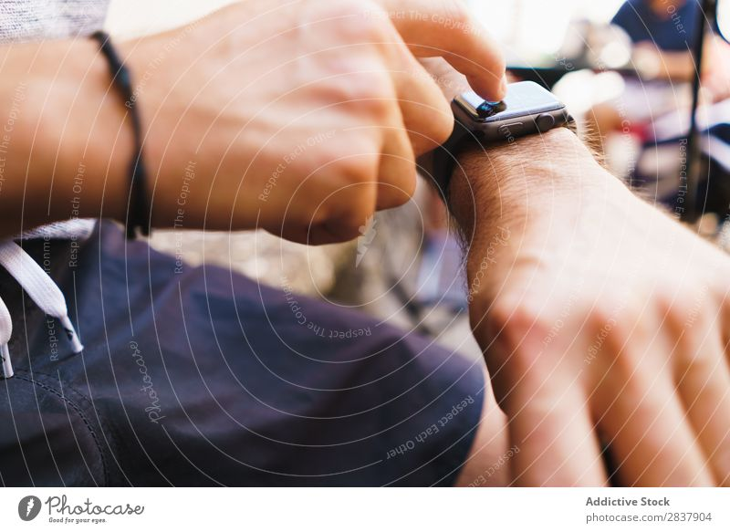 Crop man using electronic watch Man Observe Electronic smart watch Technology Digital Gadget Internet Modern Touch Decoration touchscreen Wireless Display Hand