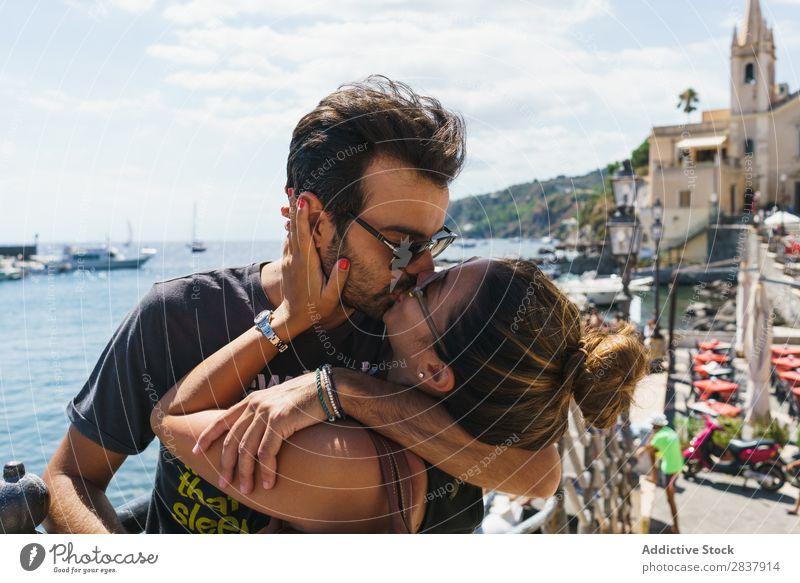 Kissing couple in sunny city Couple Traveling City Street romantic Exterior shot Vacation & Travel loving Expression Together Summer Trip embracing Skyline