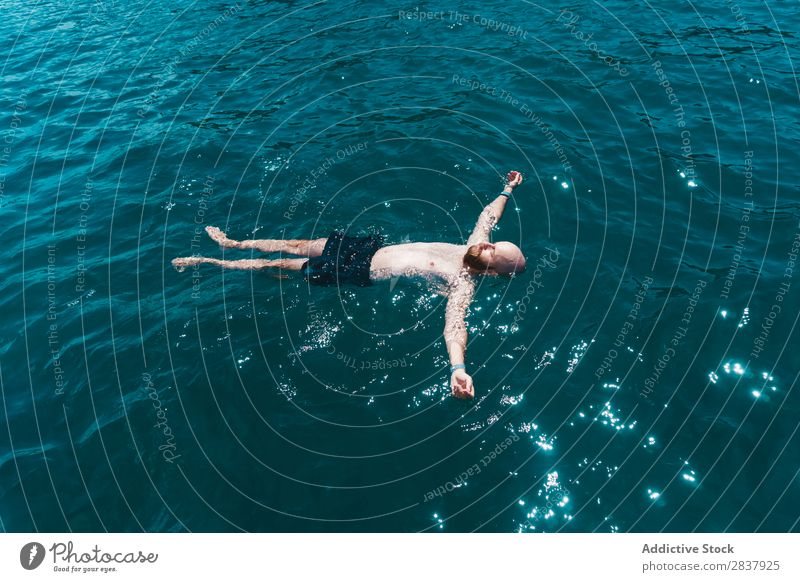 Man floating in blue water Ocean Water Floating Swimming Resort Relaxation Peace enjoyment Summer Vacation & Travel Leisure and hobbies on back