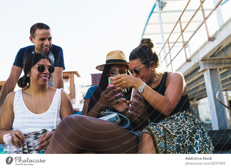 Friends with smart phones relaxing outside Human being Friendship Relaxation PDA Share Traveling Terrace Cheerful Technology Happiness Communication gathering