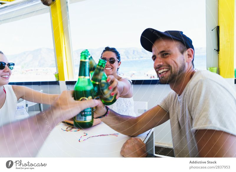 Young friends clinking with beer Human being Friendship Party Feasts & Celebrations Beer Toast Congratulations Café gathering Vacation & Travel Cheerful Meeting