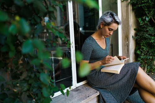 Woman reading book at window Book Street Sit Window Windowsill Beautiful