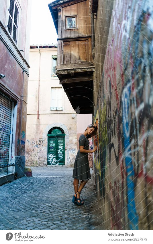 Smiling woman in alley Woman Alley Graffiti Wall (building) pretty Street Lifestyle Cheerful Calm Relaxation Blonde Walking Lovely Attractive Lady City