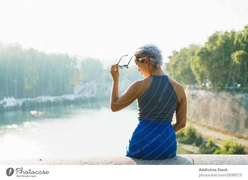 Stylish woman on fence of bridge Woman Posture Bridge Summer Town Style Youth (Young adults) romantic Vacation & Travel Relaxation Downtown Beauty Photography