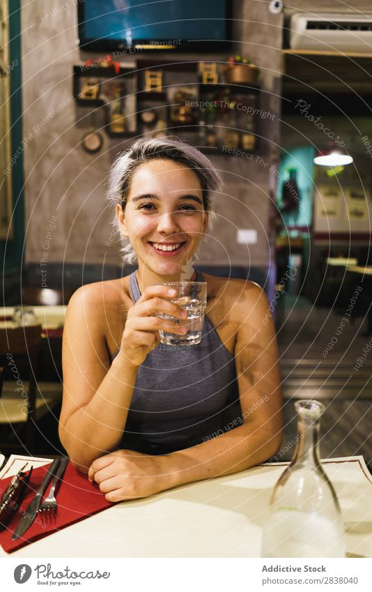Young woman with drink in bar Woman Bar Posture Feasts & Celebrations Easygoing Drinking Relaxation Interior design Pub Beauty Photography Beverage Glass